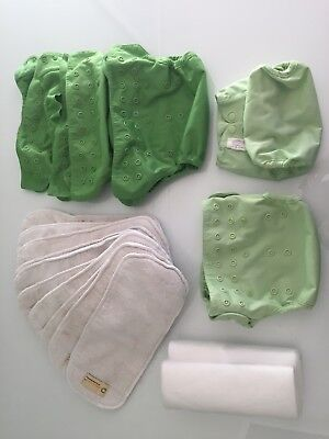 5 green Bumgenius flip nappies (wraps and inserts and disposable papers)