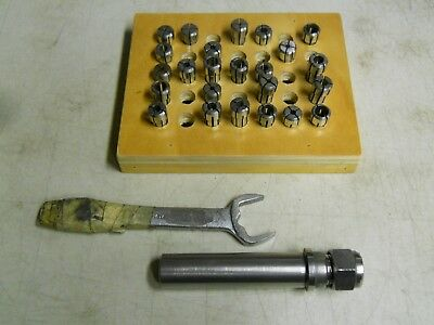 Erickson/Kennametal  Collects and Holder.   24 misc. collects    used