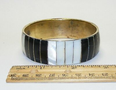 Vintage black and white inlaid mother of pearl shell and brass bangle bracelet