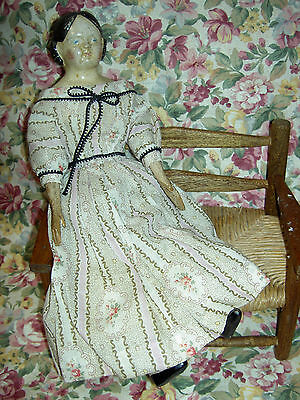 Antique papier mache Milliners model doll, leather body,wood limbs,orig.clothes