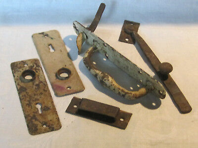 Miscellaneous lot of cast iron door hardware parts, architectural salvage