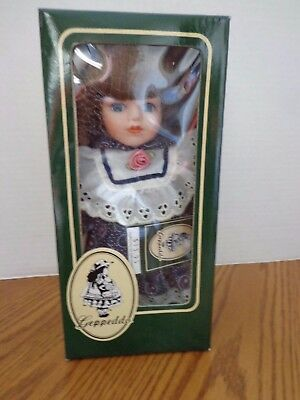 "Beautiful Geppeddo Porcelain Doll 8.5"" Tall - NIB"