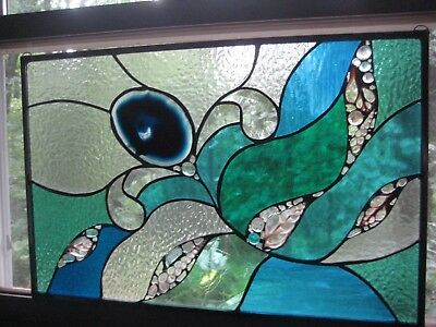 Stained glass panel window with large agate slice and sliced shells..ocean theme