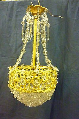 Antique chandelier empire french with amazing work of glassware.