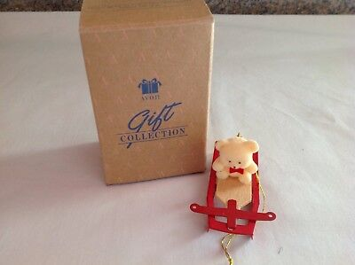 Avon Gift Collection Christmas ornament.....bear riding a sled....used...in box