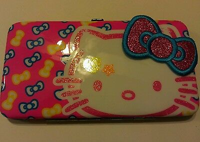 New with tags Hello Kitty neon glitter bows hardcase wallet claires store
