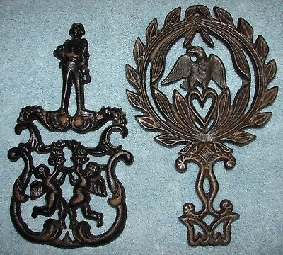 Lot of 2 Vintage Cast Iron Trivets for Hot Plates 1955 Cupid & Eagle