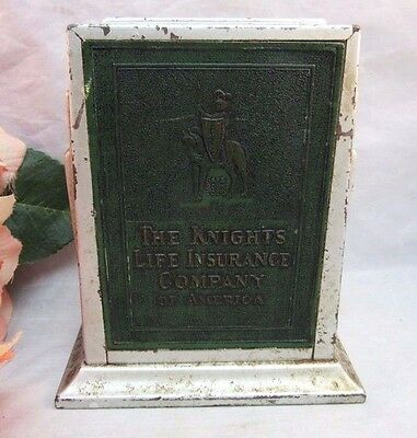 The Knights Insurance Co. advertising coin bank, picture frame