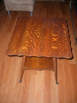 1900's quarter-sawn oak parlor table with glass feet and turned legs