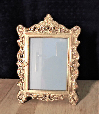 Pair of small brass art nouveau picture frames