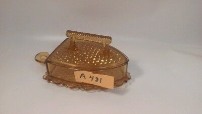 Amber depression glass bowl in the shape of a iron