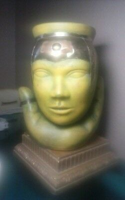 way cool ceramic,mixed metal face jar held with a seperate hand sculpture