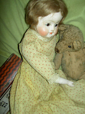 Wonderful, early 22 inch, antique paper mache, patent washable doll, glass eyes