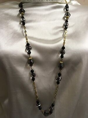 Vintage Gold Tone Necklace Adorned With Black And Clear Beads