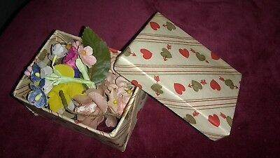 small lot of vtg millinery flowers ín a valentine heart motif covered box