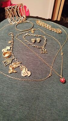 Juicy Couture Strawberry Necklace and more small lot of gold tone jewelry.