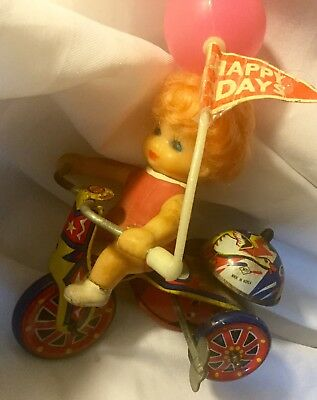 Wind Up Vintage GIRL ON TRICYCLE w/ BELL & HAPPY DAYS BALLOON Works !