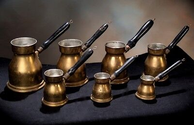ANTIQUE MIDDLE EASTERN 7PC. SET of BRASS HEATABLE MEASURING POTS WITH HANDLES