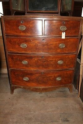 Bow front Walnut Chest of draws