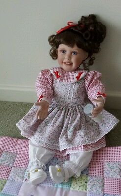 Porcelain Doll by Ashton drake galleries. A dash of laughter. Rare. New.