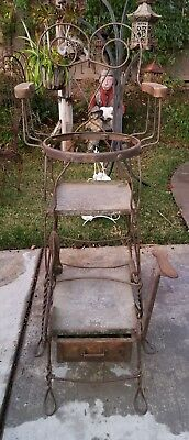 Antique Elevated Shoe Shine Chair with pull out foot rest, and supply drawer.