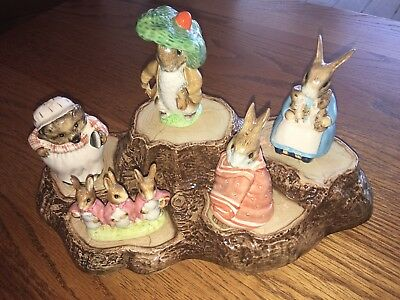 Beatrix Potter Peter Rabbit figurines with display stand