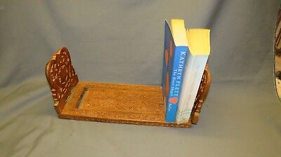A 20th CENTURY CARVED MAHOGANY ADJUSTABLE BOOK STAND