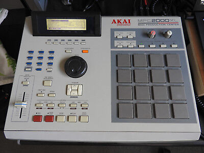 Akai MPC2000XL with 32mb RAM and drum sample floppy disks
