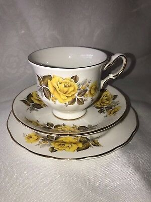 Yellow Queen Anne Antique Teacup Trio