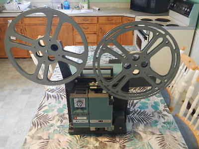 VTG BELL & HOWELL 1552 16mm Sound Film Projector With Reels bulbs & Case WORKS!