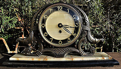 A 1930s Marble And Bronzed Spelter Mantle Clock.