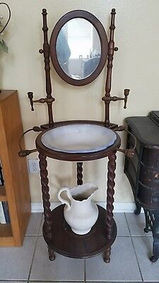 ANTIQUE WOODEN WASH BASIN STAND WITH MIRROR .  Will dismantle or you can pickup