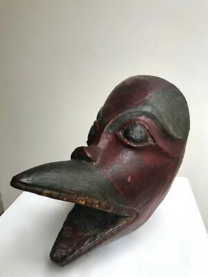 A rare and early example of a wooden mask, probably a raven, Tlingit