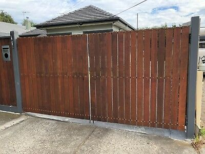 Heavy gates. Merbau decking palings, metal frame, drop bolts & top latch. Save $