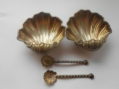A lovely pair of Victorian solid silver salt cellars with original spoons.