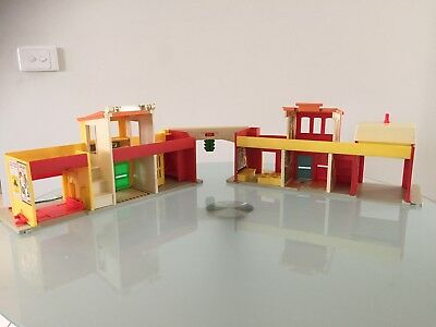 Vintage Fisher Price Play Family Village with interactive cars and little people