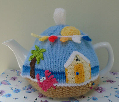 Hand Knitted Sunny Seaside Beach Hut And Bunting Tea Cosy For A Medium Teapot