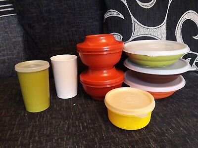 Collection of 8 vintage tupperware containers with lids