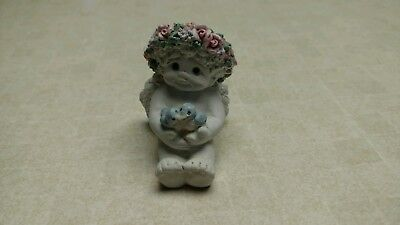 1997 Dreamsicle figurine angel cherub holding two blue birds.  Signed by Kristin