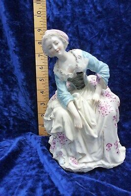 Antique Meissen Figurine of a seated fine lady with interesting history.