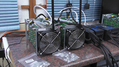 Two Antminer S1 Miners, With Power Supply.