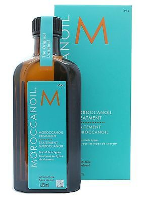 Moroccanoil Treatment With Pump 100ml, With A FREE Scented Candle