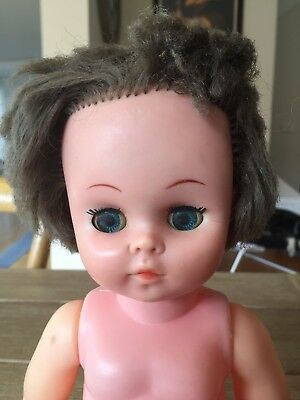 Vintage EVERGREEN Doll with dress & blinking eyes. Made in Hong Kong.