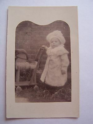 Vintage RP Postcard Small Child Pushing Toy Wooden Horse Large Woollen Hat
