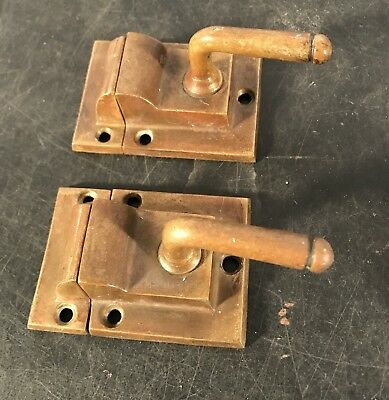Pair antique vtg beefy brass lever handle cupboard latches w/ catch
