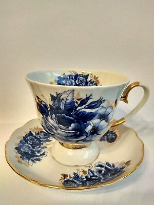 Porcelain cup and saucer hand painted Belarusian porcelain blue flowers