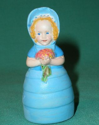 porcelain figurine of a girl with hat and floral bouquet