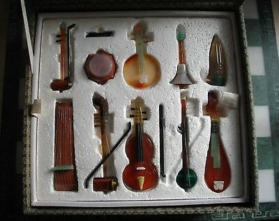 A SET OF 10 CHINESE CARVED HARDSTONE MODELS OF MUSICAL INSTRUMENTS 20th CENTURY