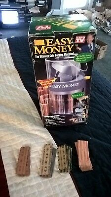 Easy Money Electric Coin Sorter includes manual  and wrappers
