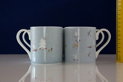4 bone china mugs by Sophie Allport, 2 of each design. Excellent condition.